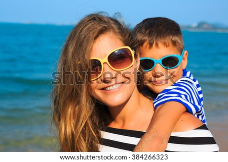little boy and his mother have a good time at the seaside resort