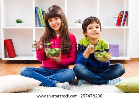 Little boy and little girl are eating healthy.Healthy meal - stock photo