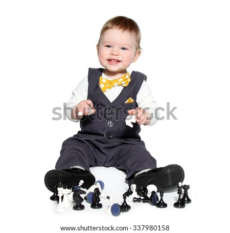 Little boy and little girl are playing chess on white background - stock photo