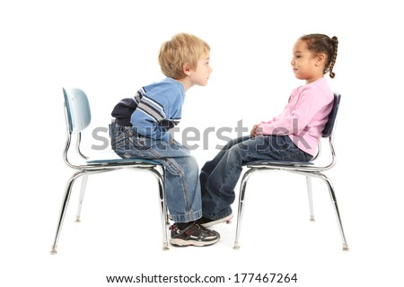 Little boy and little girl having a staring contest - stock photo
