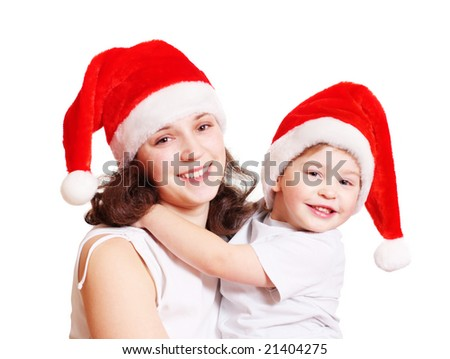 little boy and mother in christmas hats isolated on white