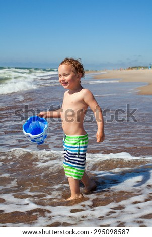 little boy and sea
