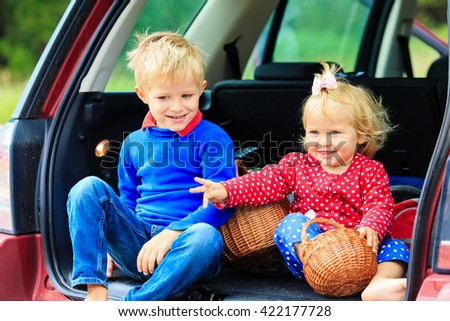 little boy and toddler girl travel by car
