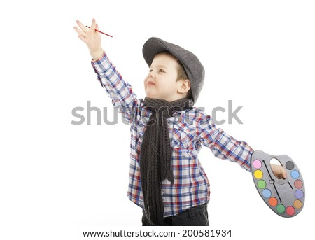 little boy as a visual artist in gym hats and holding in his hands brush painting and watercolor/ little boy painting artist - stock photo