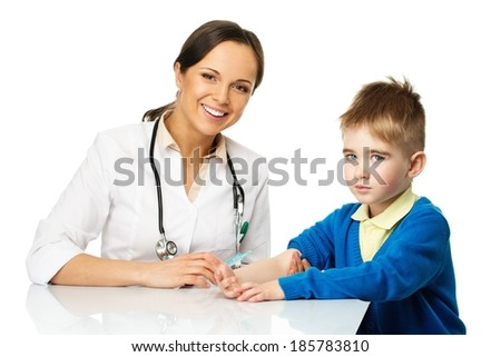 Little boy at paediatrician doing vaccination  - stock photo