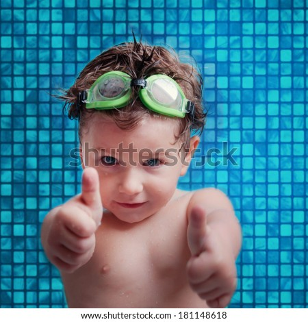 Little boy at swimming pool - stock photo