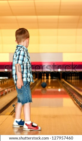 little boy at the bowling alley - stock photo