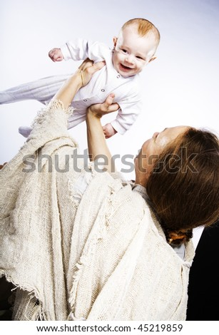 Little boy at the hands of the mother