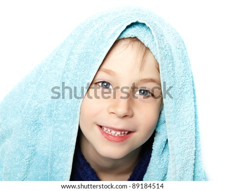 little boy beautiful after shower with bath towel and bathrobe