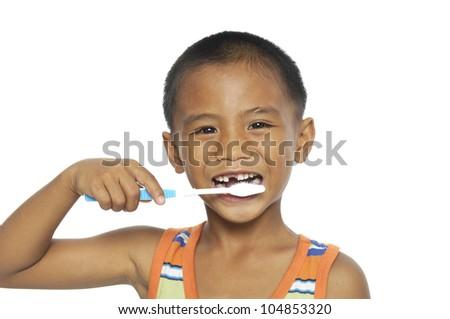 little boy brushing teeth, isolated on white - stock photo