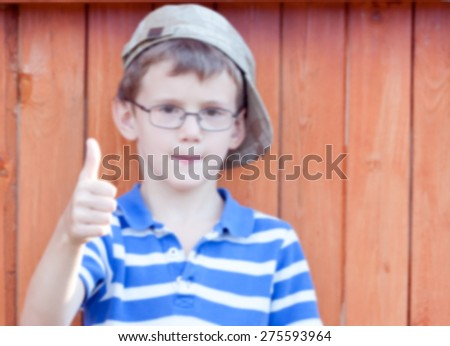 little boy bully showing a positive gesture.blurry photos for your design - stock photo
