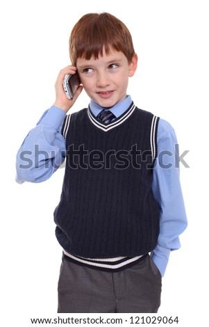Little boy calling by phone - stock photo