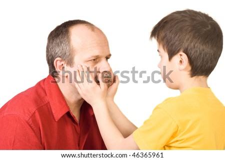 Little boy caressing his father