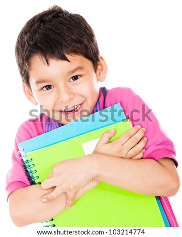 Little boy carrying notebooks to study - isolated over a white background