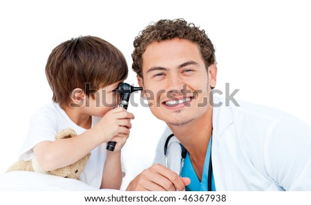 Little boy checking doctor's ears against a white background - stock photo