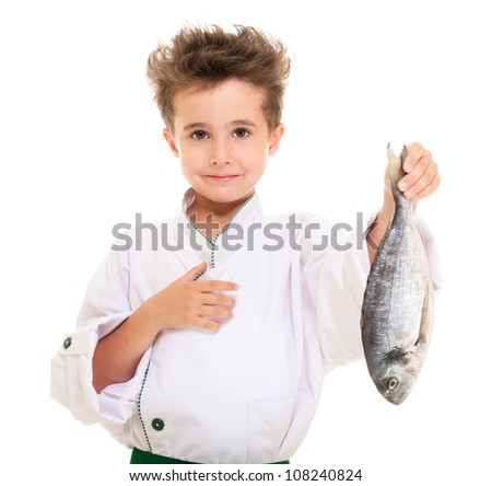 Little boy chef in uniform presenting  dorado fish isolated on white - stock photo