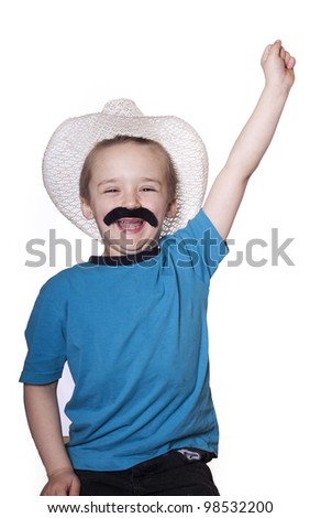 Little boy cherring with arms up and a cowboy hat with fake mustache.