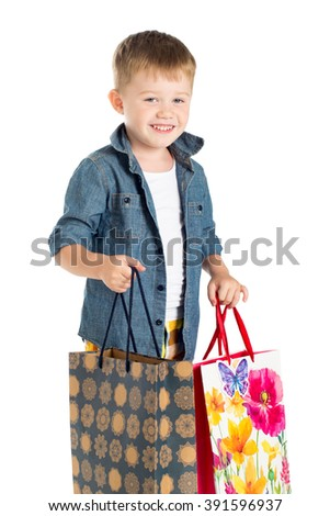 Little boy child on white background with gift bags