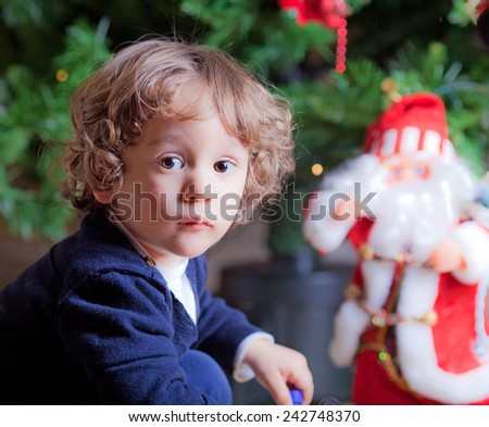 Little boy close to a Christmas tree  - stock photo