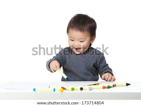 Little boy concentrate on drawing - stock photo