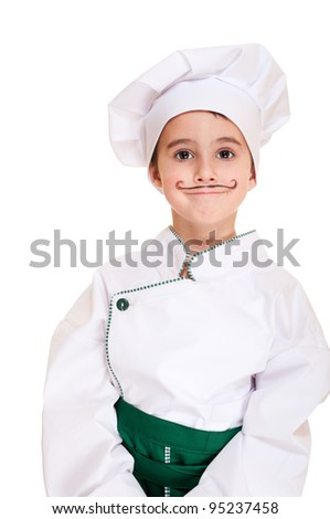 Little boy cookee in trying out uniform isolated on white - stock photo