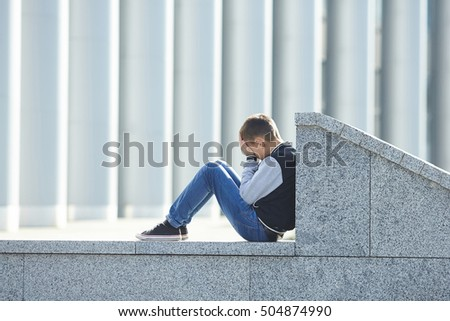 little boy crying on the street, negative emotion