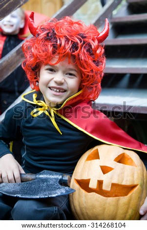 little boy curve faces in fairy costume on holiday halloween - stock photo