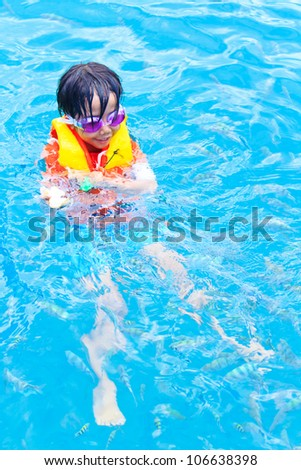 little boy diving in the sea, thailand - stock photo