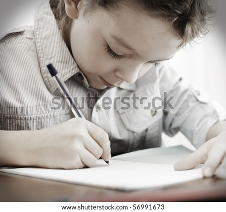 Little boy does a homework