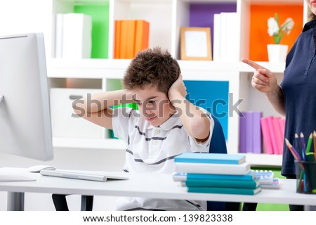 Little boy does not want to hear reproach his mother - stock photo