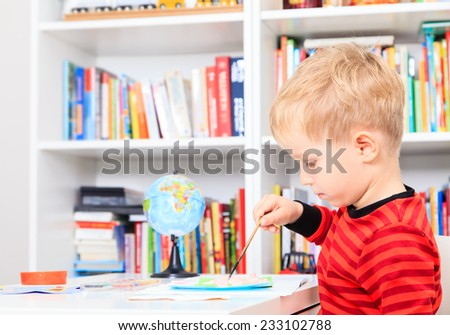 little boy doing homework, early education - stock photo