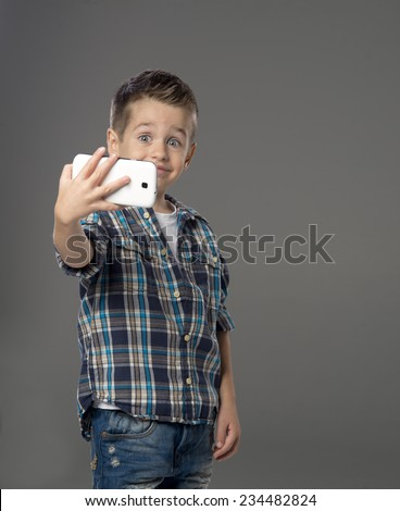 Little boy doing photo of him self over  - stock photo