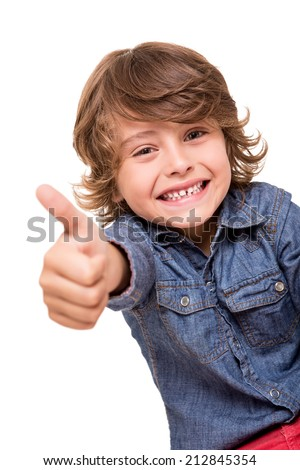 Little boy doing thumbs up for camera - stock photo