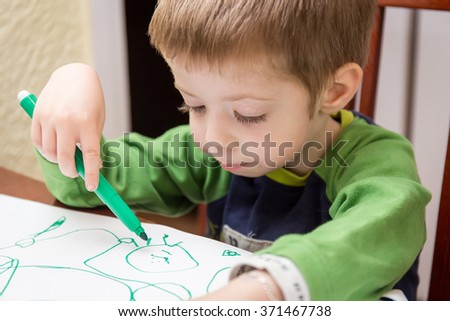 little boy drawing at home room - stock photo