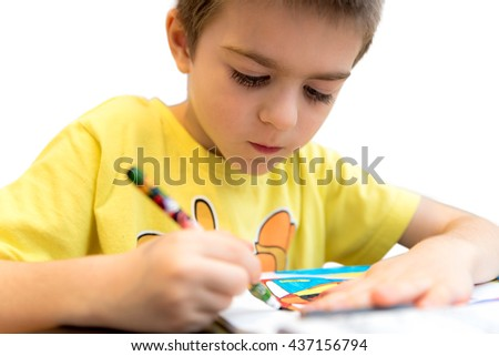 Little boy drawing with colorful pencils
