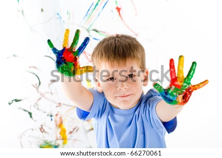 little boy draws bright colors - stock photo