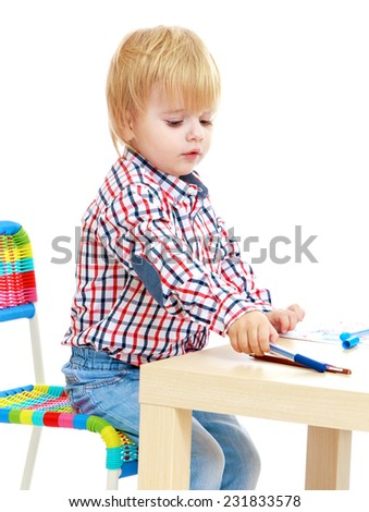 Little boy draws felt-tip pens.Childhood education development in the Montessori school concept. Isolated on white background. - stock photo