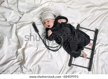 Little boy dressed as a chimney sweep - Suitable as a beautiful New Year's card - stock photo