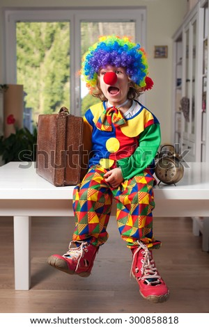 Little boy dressed as a clown with a surprised expresion - stock photo