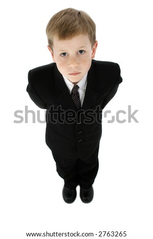 Little boy dressed in a suit; full body, on white background