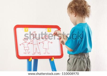 Little boy drew a family on a whiteboard - stock photo