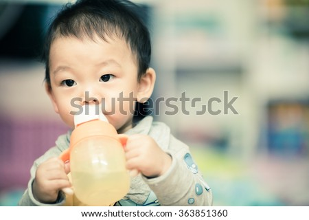 Little boy drink water from bottle - stock photo