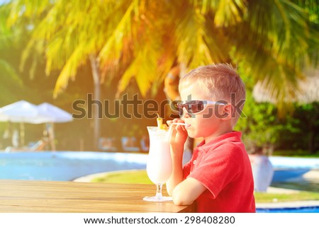 little boy drinking cocktail on tropical beach resort - stock photo
