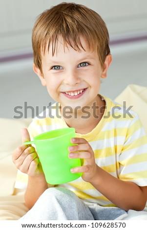 Little boy drinking milk - stock photo