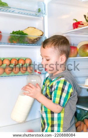 little boy drinking milk from the bottle - stock photo