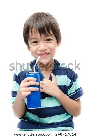 Little boy drinking soft drink can on white background - stock photo