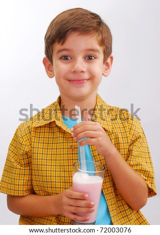 Little boy drinking strawberry milkshake,boy drinking milk,