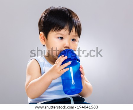 Little boy drinking water