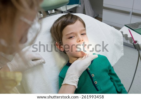 little boy during procedure at the dentist's office - stock photo