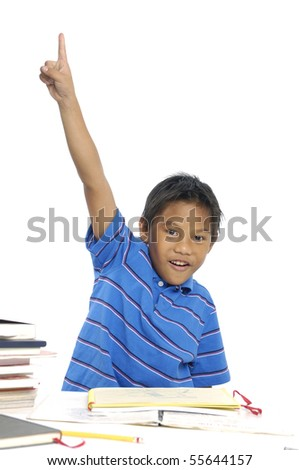 Little boy eager to answer a question, finger raised - stock photo